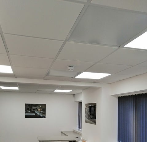 Herschel white panels ceiling mounted in office space